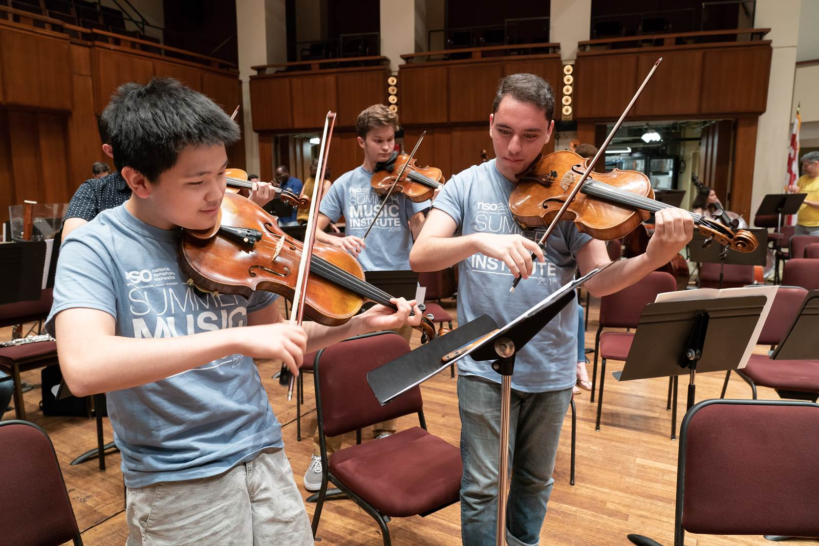 Students participating in a side by side rehearsal with NSO musicians in the Concert Hall.
