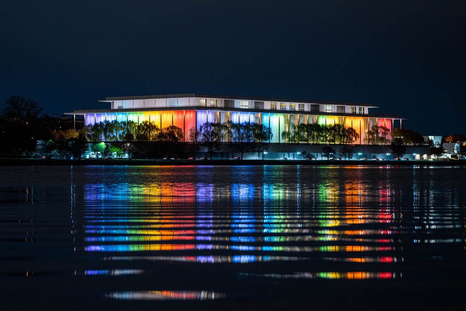 The John F. Kennedy Center for the Performing Arts lit up in the colors of the rainbow for the annual Honors celebration.